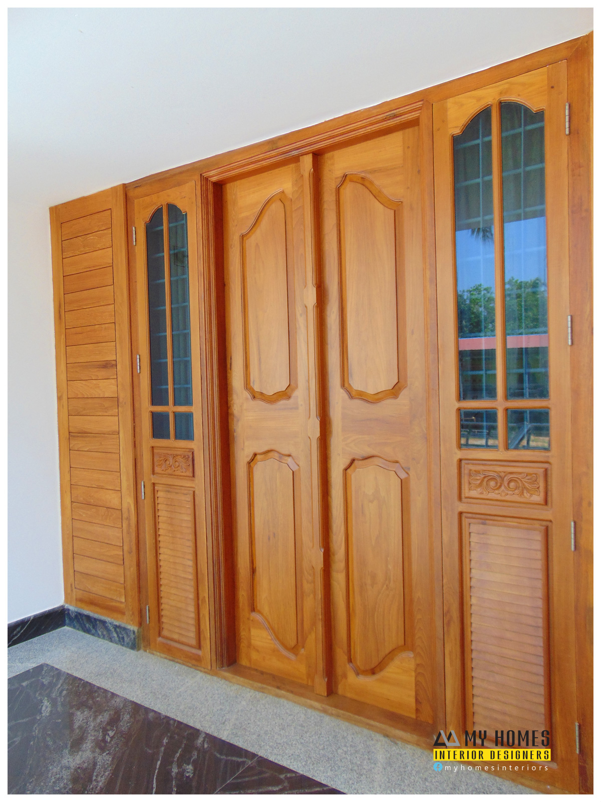 Door design kerala kerala interior designers for Main two door designs