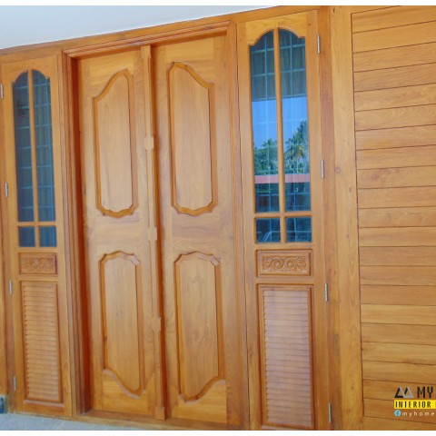 latest homes style wooden kerala door designs
