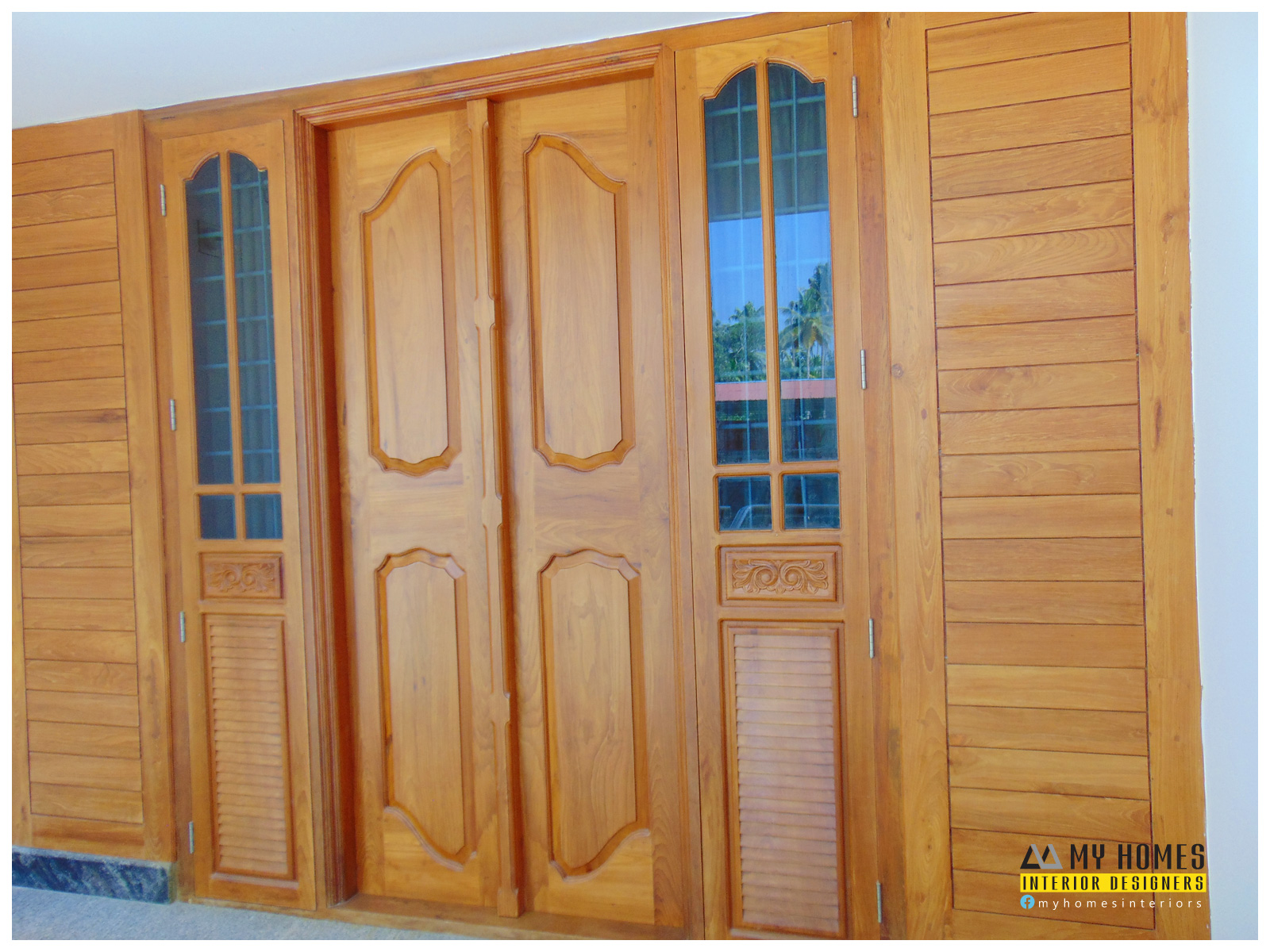Kerala traditional double door designs joy studio design for Window glass design in kerala